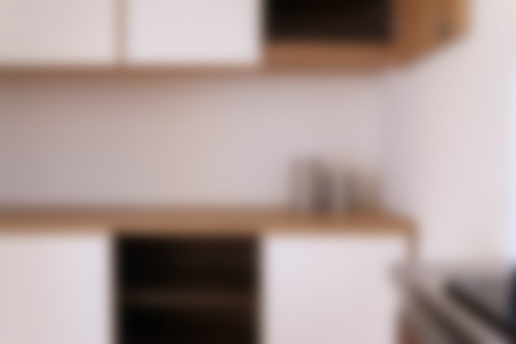 個人宅カップボード: 村松英和デザインが手掛けたキッチンです。