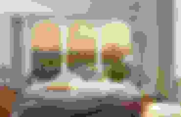 Dormitorios de estilo  por DeColor