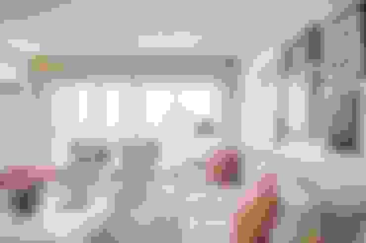 Espinho . Interdesign: Sala de estar  por Interdesign Interiores
