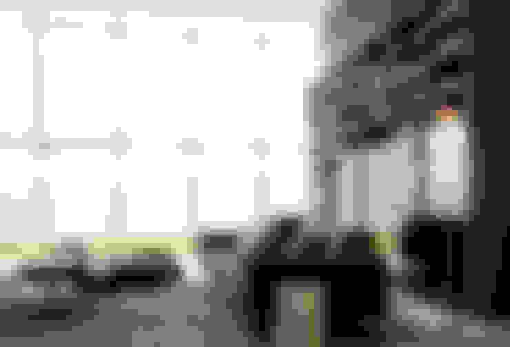 Salas/Recibidores de estilo  por MANTRA ILUMINACION