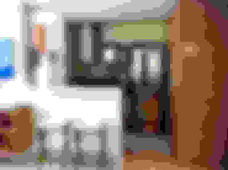 Cozinha americana: Cozinhas  por Jaqueline Vale Arquitetura