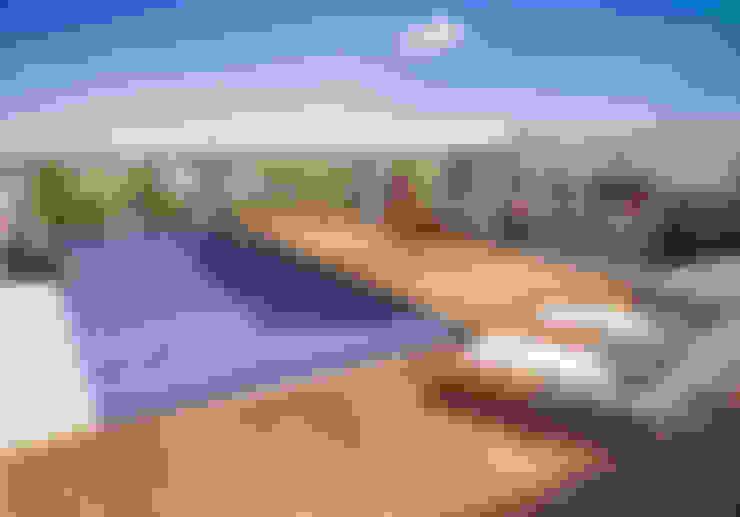 EDIFICIO BELGRANO CENTRO - Autores: Mauricio Morra Arq., Diego Figueroa Arq. y Arte de Dos: Piletas de estilo  por Mauricio Morra Arquitectos