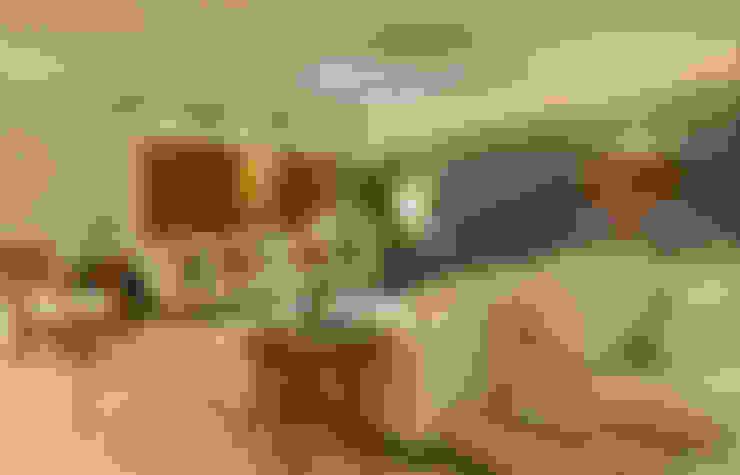 APARTAMENTO PK: Salas de estar  por Bastos & Duarte