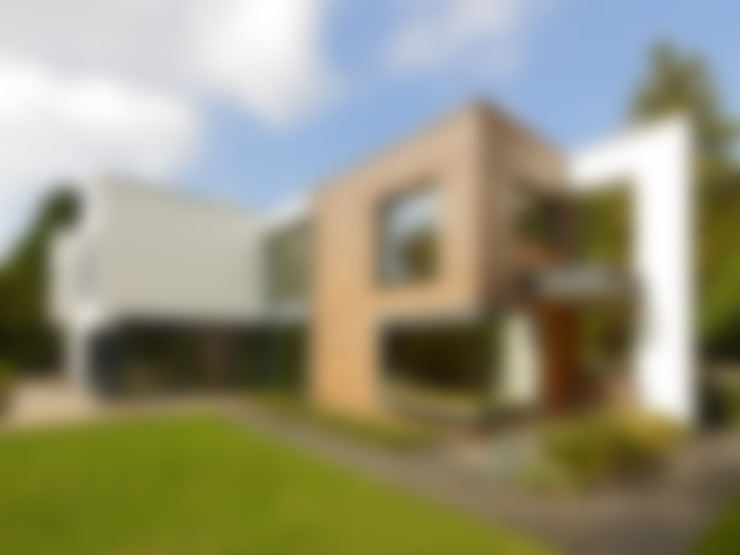 Case in stile  di Baufritz (UK) Ltd.