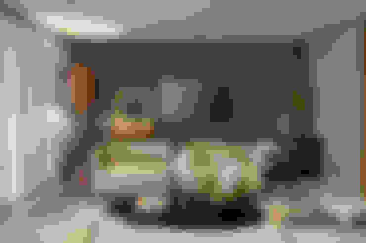 Apartamento Vila da Serra II: Salas multimídia  por Juliana Goulart Arquitetura e Design de Interiores