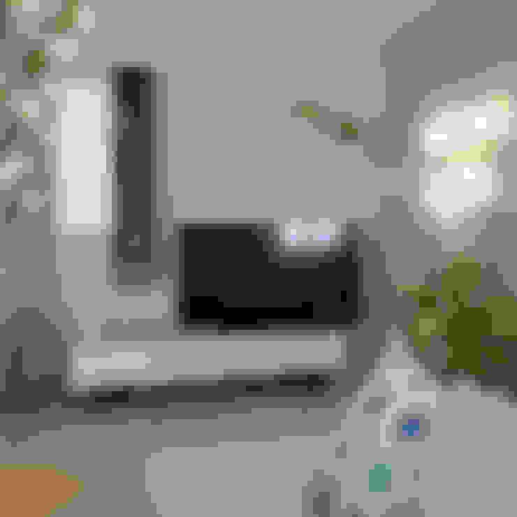 Salas / recibidores de estilo  por Skéa Designer