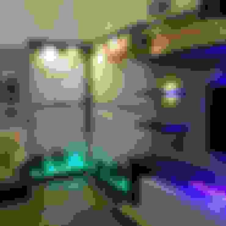 Salas / recibidores de estilo  por Disha Interior