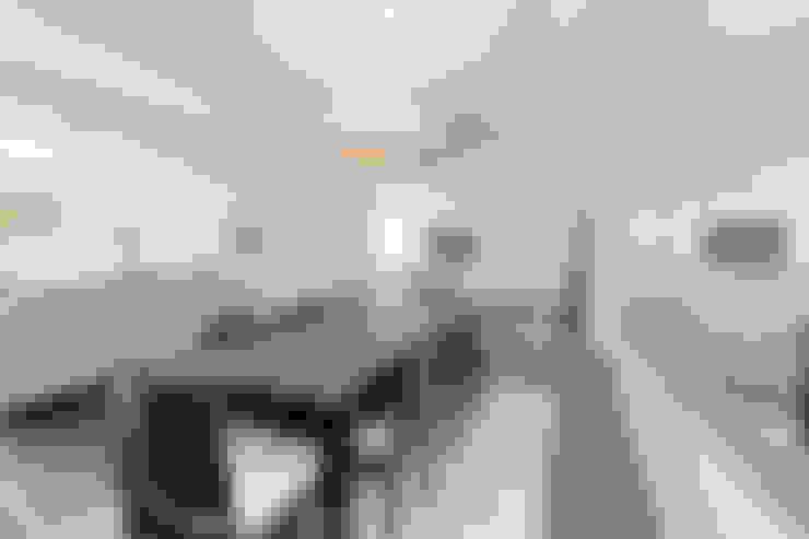 Salas de jantar  por New Images Architects