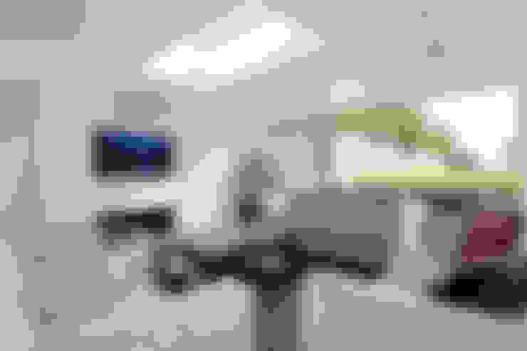 Salas de estar  por New Images Architects