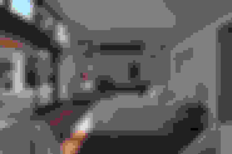 Dormitorios de estilo  por José Vigil Arquitectos