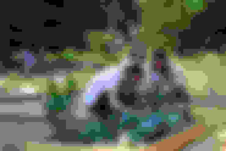 Jardines de estilo  por Atelier delle Verdure