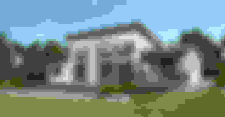 de estilo  por Symbioses - Design & Construção