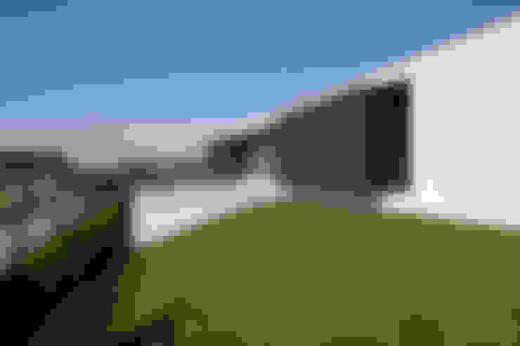 Casas de estilo  por aaph, arquitectos lda.