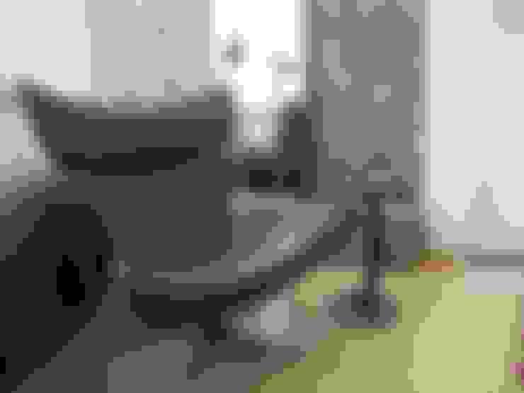 Salas de estilo  por TRIBU ESTUDIO CREATIVO