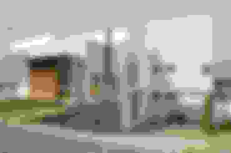 Casa Tatuí: Casas  por Flavio Vila Nova Arquitetura