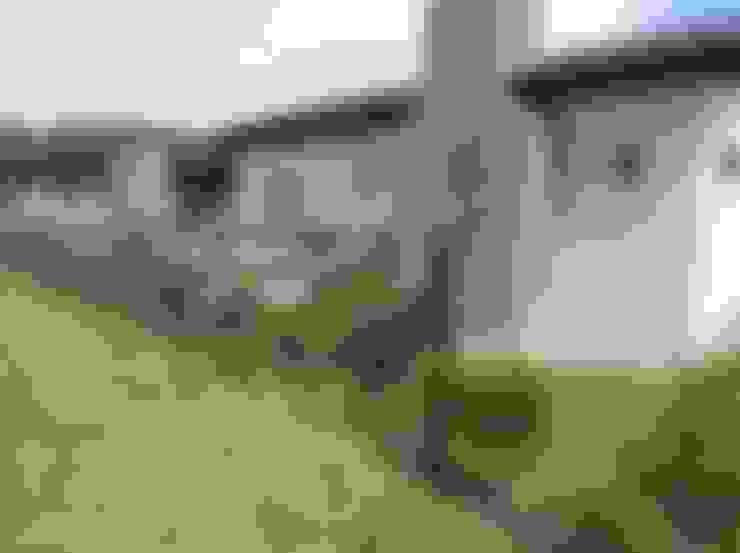 บ้านและที่อยู่อาศัย by Estudio de arq. Tomás Hosmann