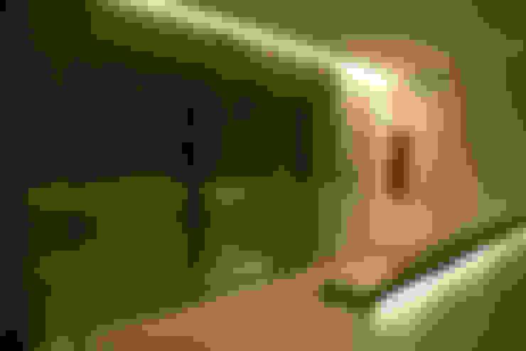 Palier de ascensores: Pasillos y recibidores de estilo  por Estudio de iluminación Giuliana Nieva