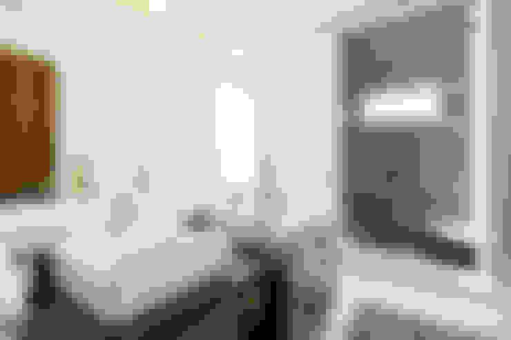 Banheiros  por J-M arquitectura
