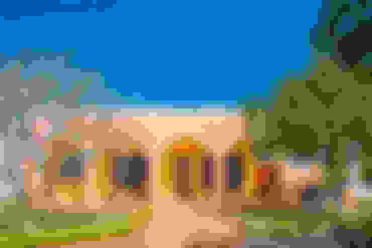 Casas  por PORTO Arquitectura + Diseño de Interiores