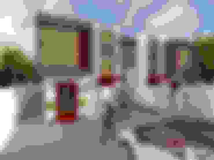 Casas de estilo  de om-a arquitectura y diseño