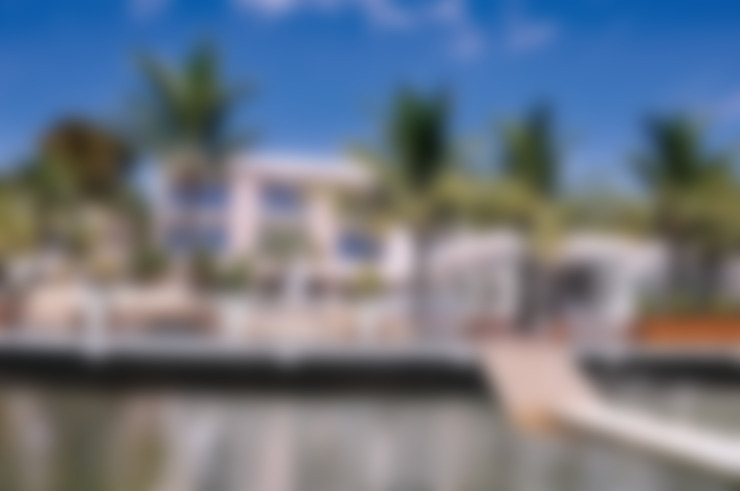 Fachada voltada para o Lago: Casas  por A/ZERO Arquitetura