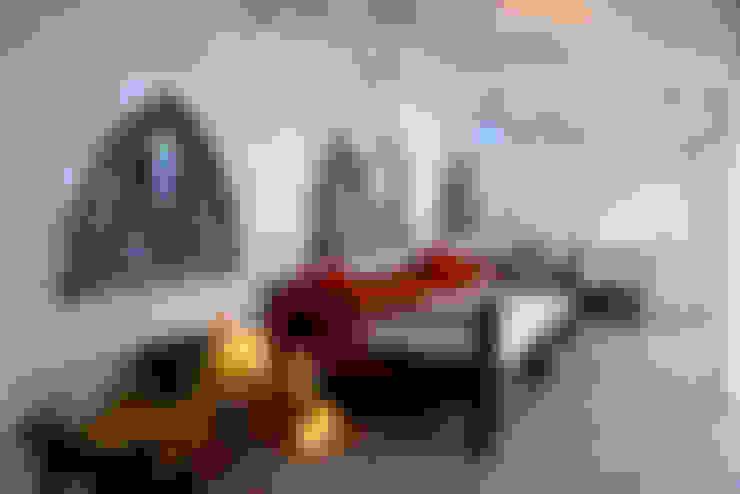 Balcones y terrazas de estilo  por Decoración Andalusí Iluminación