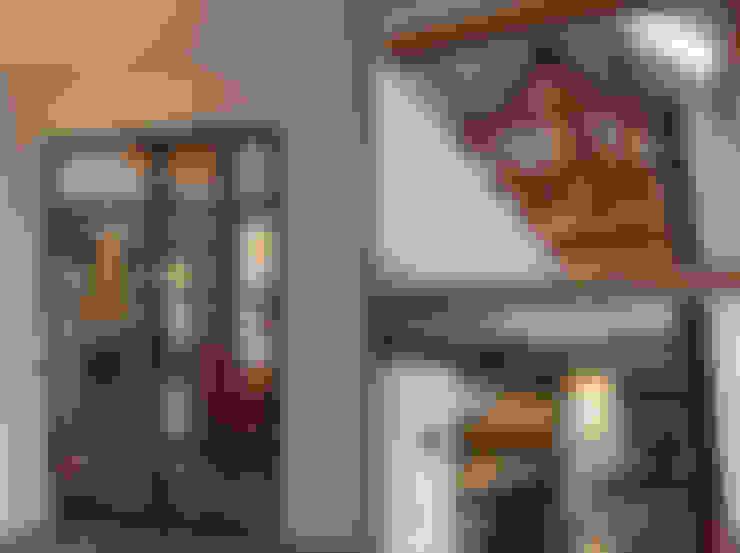 VERBOUWING VAN OUDE BOERDERIJ TOT MOOIE WOONBOERDERIJ:  Woonkamer door ID-Architectuur