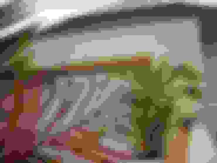 Casa García- Resistencia Chaco: Terrazas de estilo  por Arq.Rubén Orlando Sosa