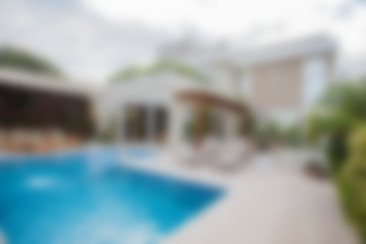 área de piscina e lazer: Casas  por Heloisa Titan Arquitetura