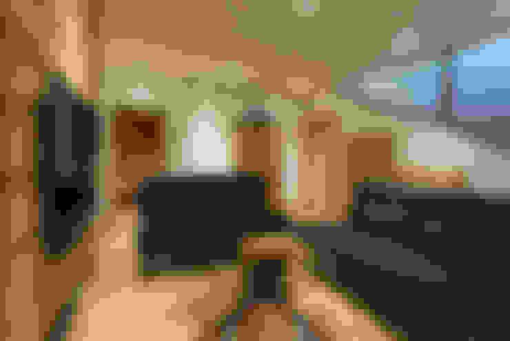 Salas de estar  por Chevallier Architectes