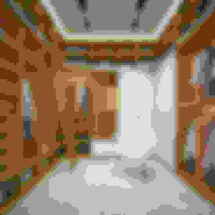 Walk in closet de estilo  por LK&Projekt GmbH