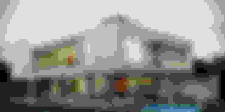 Casa C: Casas  por Martins Lucena Arquitetos