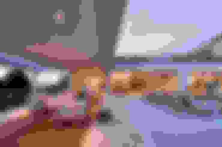 Casa nas Mangabeiras: Terraços  por Lanza Arquitetos