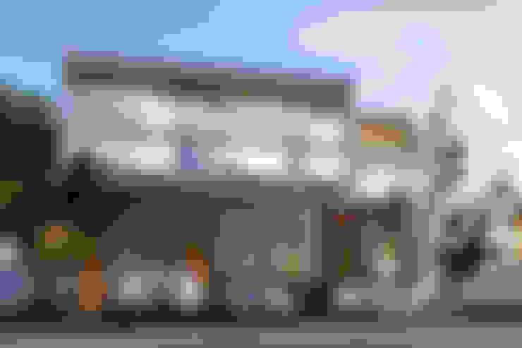 บ้านและที่อยู่อาศัย by Entorno Arquitectura