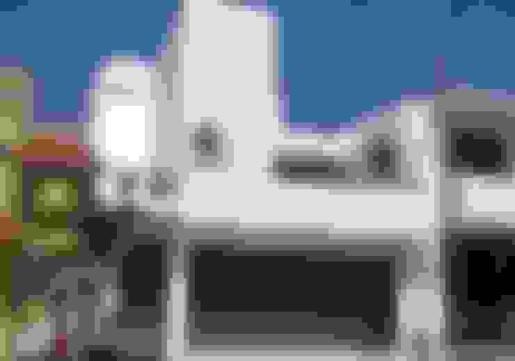 Casas de estilo  de T+E ARQUITECTOS