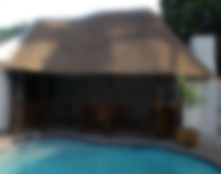 Thatch lapa by pool:  Pool by Cintsa Thatching & Roofing