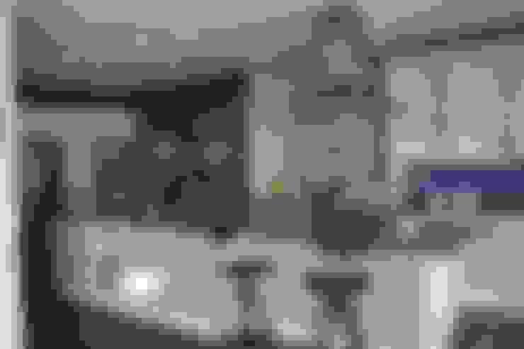 Kitchen by Arquimia Arquitectos