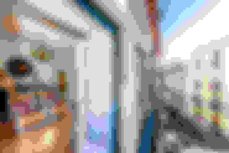 Um apartamento com um toque descontraído de campo em plena cidade.: Casas  por alma portuguesa