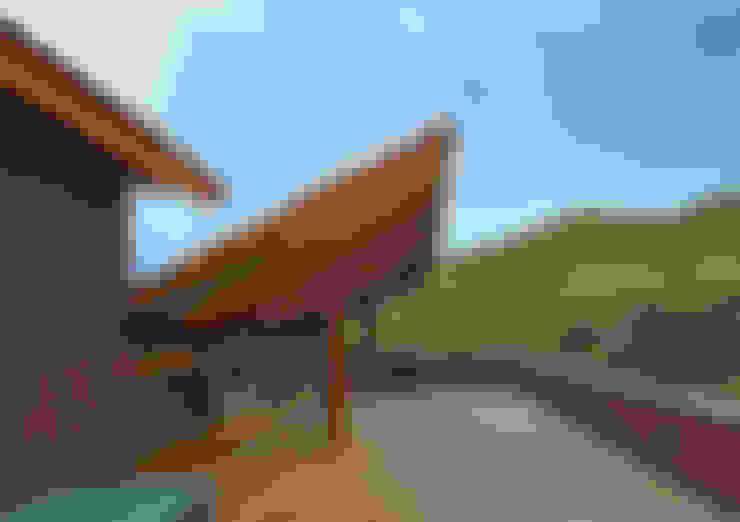 Terrazas de estilo  por David Guerra Arquitetura e Interiores