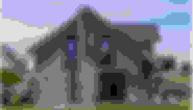 Casas de estilo  por KitzlingerHaus GmbH & Co. KG