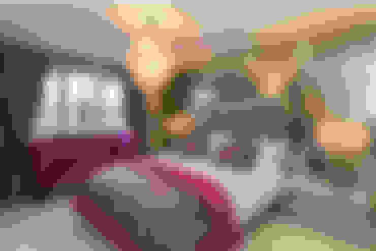 Dormitorios de estilo  por Graeme Fuller Design Ltd
