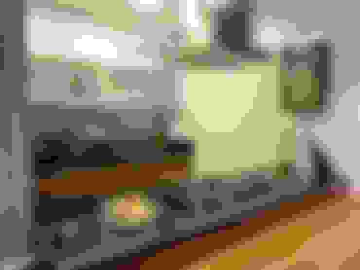 cozinha integrada: Cozinhas  por Maria Helena Torres Arquitetura e Design