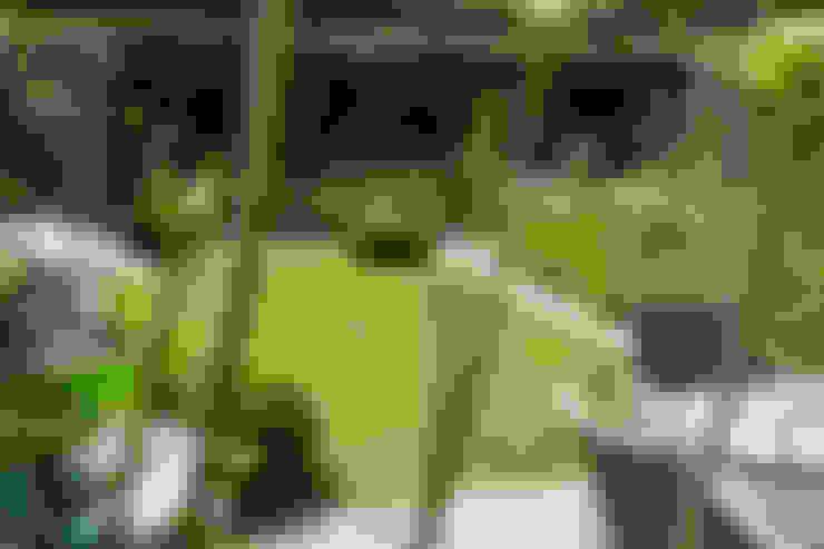 Jardines de estilo  por Woodsford Landscapes