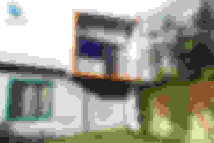 Fachada: Casas unifamiliares de estilo  por NidoSur Arquitectos - Valdivia