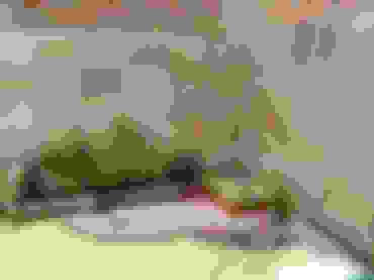 Giardino in stile  di Arqca