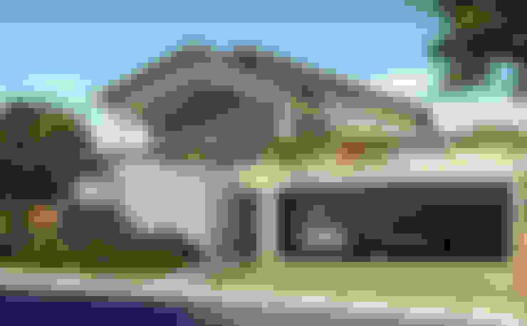 Houses by Santos e Delgado Arquitetura e Construções
