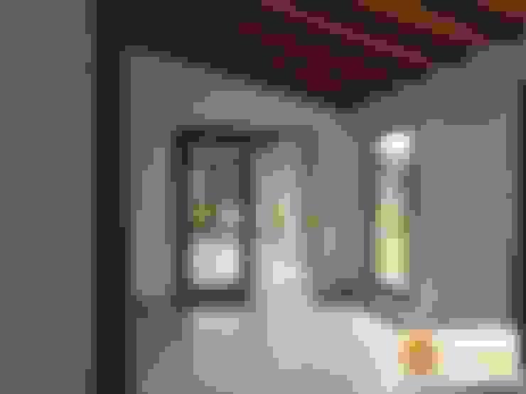 Casa pre fabricada en bogotá: Salas de estilo  por PREFABRICASA