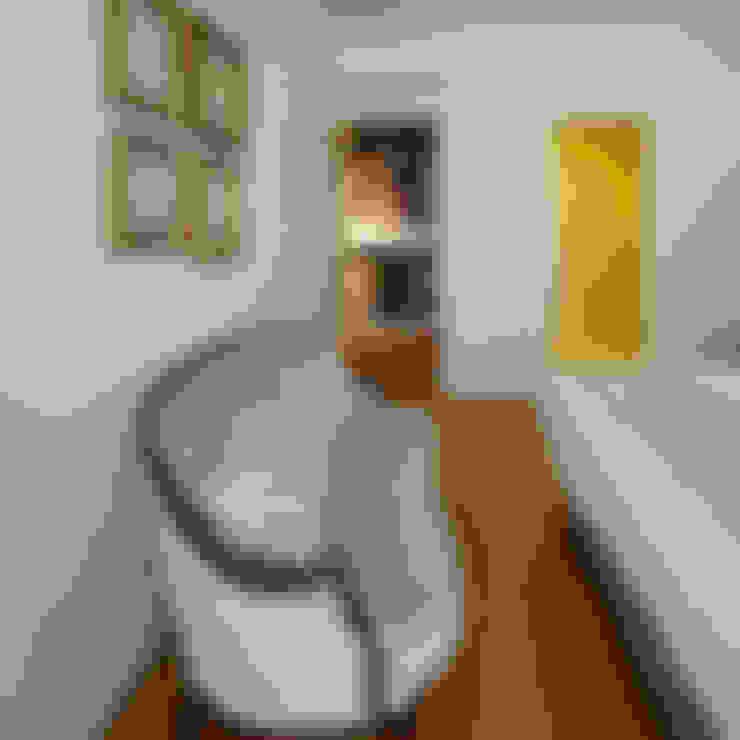 Dormitorios de estilo  por MapOut