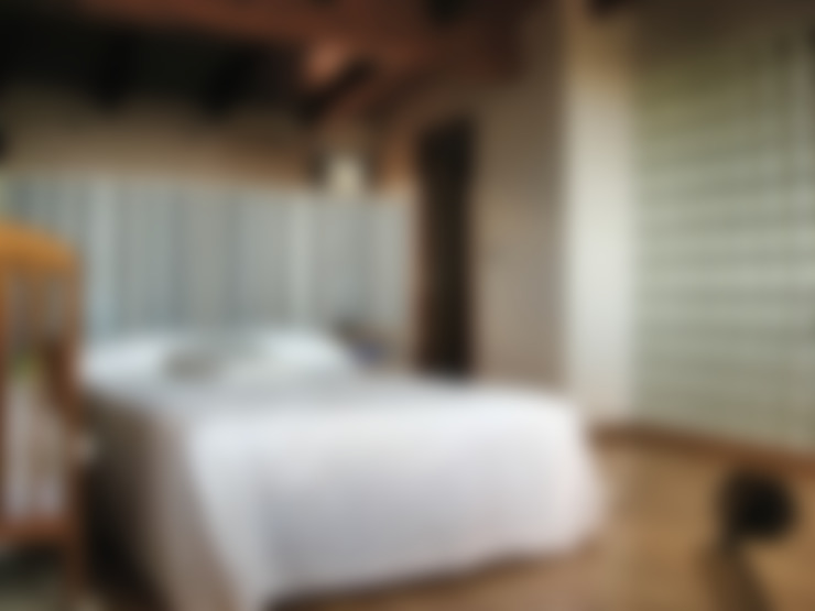 Dormitorios de estilo  por Intra Arquitectos