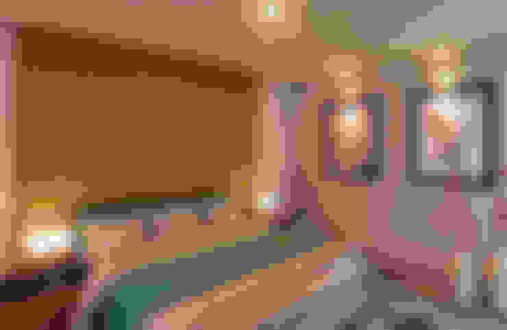 Dormitorios de estilo  por GRUPO ESCALA ARQUITECTOS